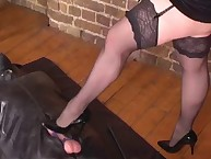 Two leather fetish girls are humiliating their foot slave man