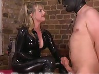 Rubber Madam uses her bondman for pleasure