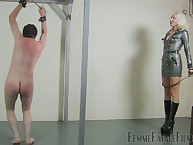 Latex mistress thrashed nude slave