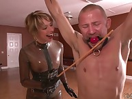 Latex milf flogging a gagged submissive