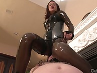 Facesitting with domme in latex dress