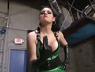 Brunette domme in green latex trains new sub