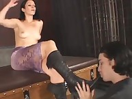 The stockinged brunette domina has her toes and soles licked
