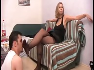 The blamed slave strains under her feet