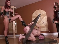 Bound sub was caned by two dommes