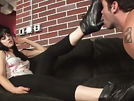 Males slave licking boots of brunette mistress