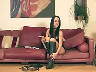 The dominatrix has her feet loved