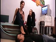 Lady domina kicks her submissive dude