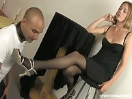 A slave is happy to lick the pantyhosed feet
