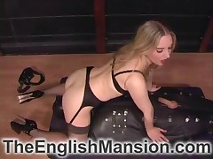 Dominatrix in leather clothes likes dominating her subby