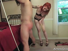 Sub guy getting spanking from tattooed mistress