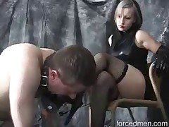 Domme is sitting and enjoying foot licking from slave