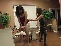 Slutty mistress giving domestic torture to sub
