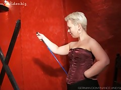 Dominatrix with blue eyes was caning slave brutally