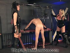 sadistic caning for slave in a chastity lock