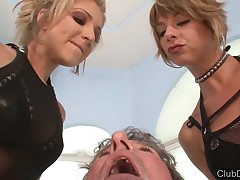 Twosome spitting dominatrixes