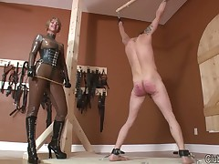 Latex milf paddling a gagged submissive