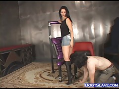 Brunet mistress enjoyed boot worship from serf