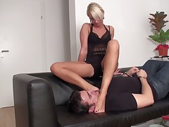 Blond Dominatrix likes getting feet licked by subby