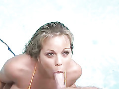 Cute babe Amber deepthroat sucking cock by the pool