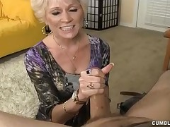 Blonde horny girl stroking huge cock and swallows cum