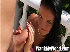 Sexy hot brunette babe treats big rod with hands