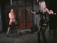 A blonde slave girl takes a whipping