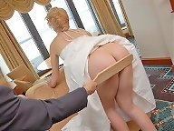 Husband giving paddling to wife