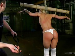 Crucified Nicole was harsh breast, pussy and ass whipped.