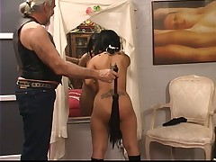 Beautiful young tattooed asian girl is tormented and spanked by Master Len