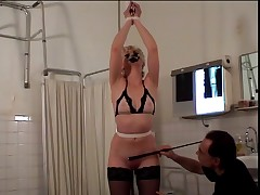 Blonde with a nice rack made to strip and bound by her master for BDSM