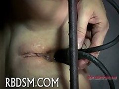 Torturing gal with sex-aids
