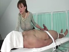 Big titted milf tugging bound guys cock and loves it