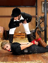 Blonde hogtied in the stable