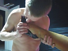 Domme in Stockings Crops Guy and Gets Foot Worship