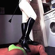 Mistress tramples slave on the kitchen