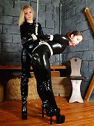 Black latex female bondage