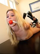 Decorative blonde chick hogtied on the table
