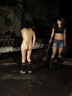 <!–-IMAGE_COUNT-–> of Mistress Angie spanks Lola in a dirty factory