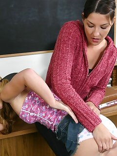 <!–-IMAGE_COUNT-–> of Hot brunette school teacher spanks blond students ass hard
