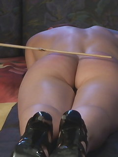 <!–-IMAGE_COUNT-–> of Adrienne`s Painful Caning
