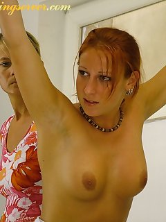 16 of Blonde and redhead gets spanked