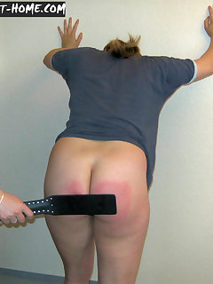 <!–-IMAGE_COUNT-–> of Blonde girl gets leather paddle