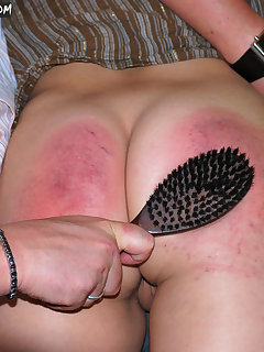 12 of Girl gets spanking by hairbrush