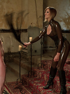 12 of Latex lady whipping and pinching her sub before fuck