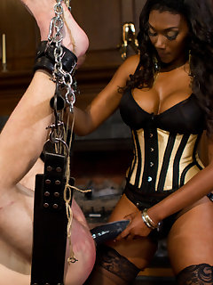 12 of Pretty ebony pinches slave's dick and fucks him with dildo