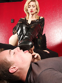 12 of Manchester makes slave boy lick on her boots