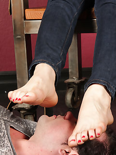 12 of Mistress O buries her bare feet on the face of her slave