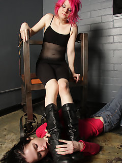 12 of Sophie demands her slave girl lick her boots clean at her throne