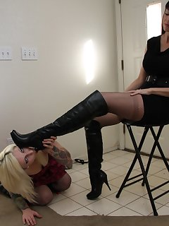12 of Emily sits high up and makes her slave girl lick her boots